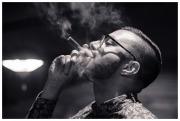 Martin enjoys a cigar