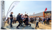 Arm wrestling in the Volvo Truck stand at Sweden Rock