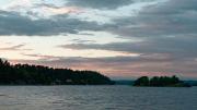 Setting sun colours the clouds behind Stillingsön.