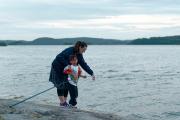 Maria helping Leo to fish.