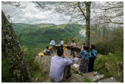 A guy and his mates preparing a marriage proposal with a magnificent view.